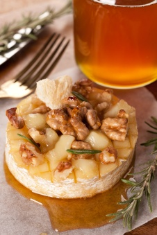 Baked cheese with honey, rosemary and walnuts