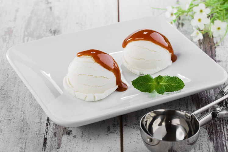 white ball ice cream with caramel