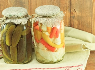 Mixed pickled vegetables in glass jars