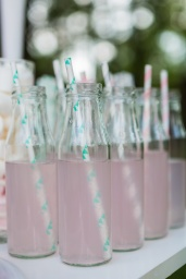 small glass bottles with pink lemonade