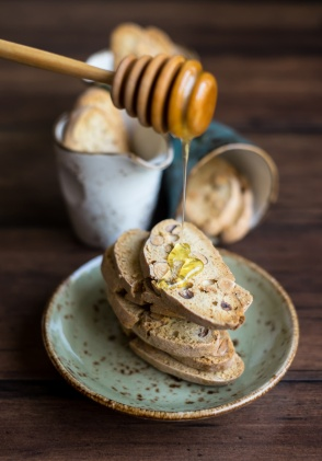 Traditional homemade italian cantucci or cantuccini cookies with almond nuts and honey