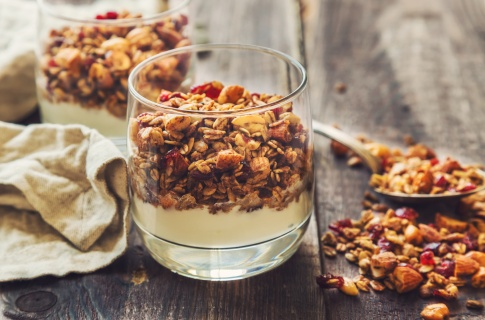 Homemade granola, muesli with yogurt in glasses