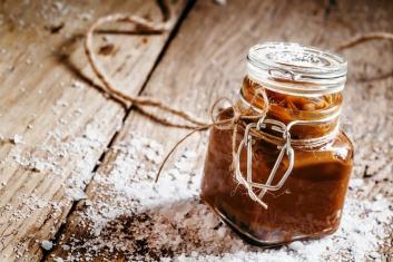 Salted caramel in a glass jar, selective focus
