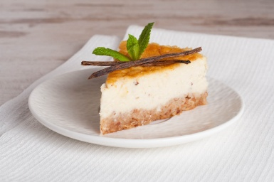 Vanilla cheesecake on a white plate, close up