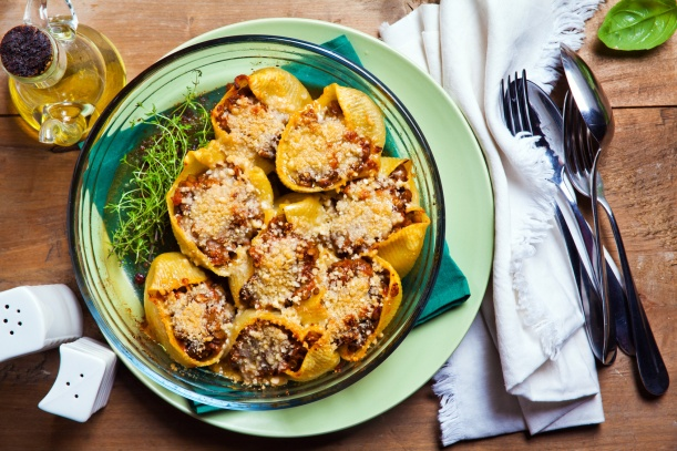 Baked Stuffed Pasta Shells on wooden table