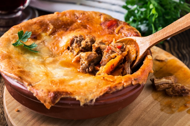 Juicy meat pot pie in a ceramic oven pot
