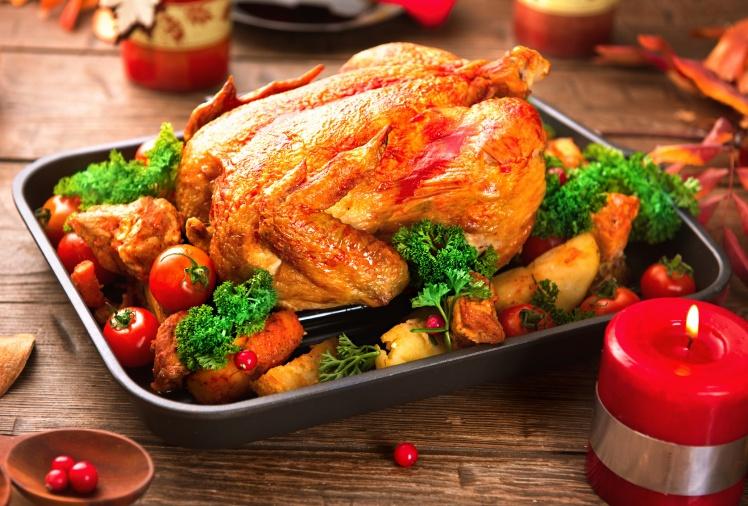 Christmas dinner. Roasted turkey on holiday served table