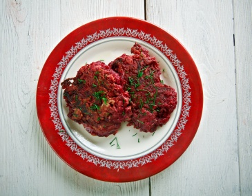 Beet Fritters on a wooden surface. traditional  german cuisine