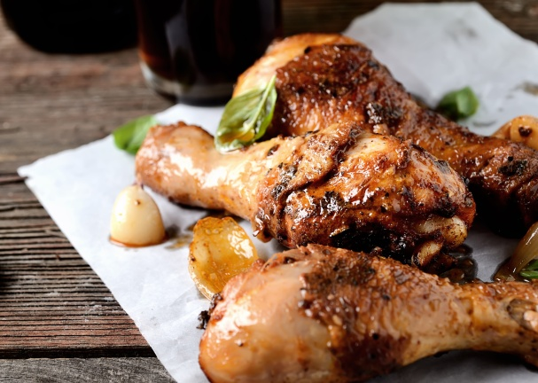 fried chicken legs on a culinary paper. rustic style