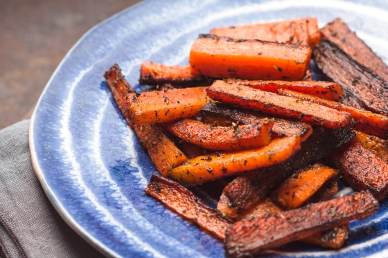 Roasted carrots on ceramic dish on a napkin horizontal
