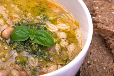 Fresh minestrone soup, made with mixed vegetables, white cannelini beans and pasta shells, topped with fresh pesto, basil oil and a sprig of fresh basil. Served with seeded brown bread.
