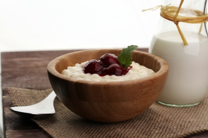 Milk rice pudding with hot cherries
